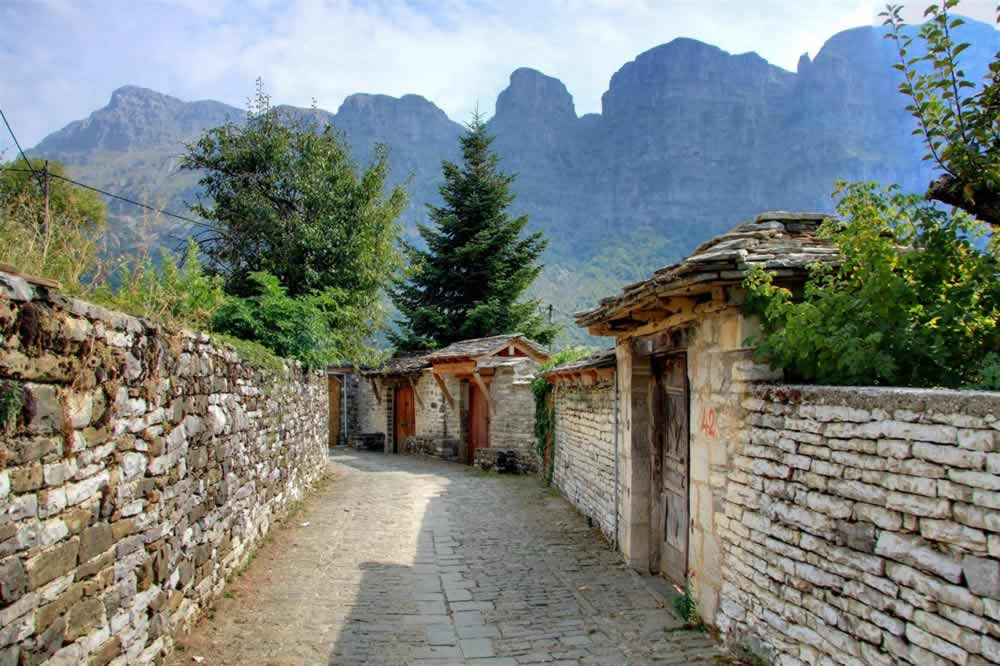 A traditional and old cobble trek in Megalo Papigo village with a view to Gamila