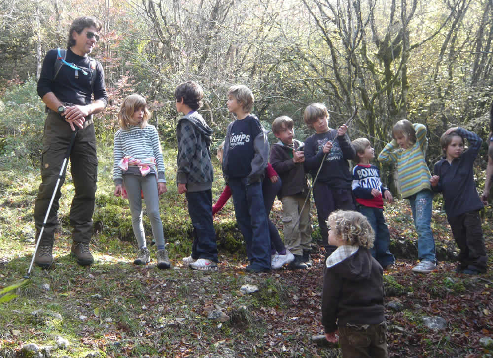 The experienced guide, Vassilis Nasiakos, with a group of children during a trekking excursion in the Zagori region