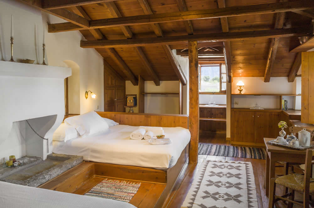 Accommodation in M. Papigo, Zagori, Vikos-Aoos | Family Room (4pax): 27 square meters of total private space, Two Double Beds, Laura Ashley Linens, Coco-Mat Mattresses and pillows, En-Suite Bathroom, Hair Dryer, Bathroom Amenities, Scented Candles, Coffee/Tea Making Facilities, Daily Housekeeping, Bathtub, Rainfall Showerhead, Free Wi-Fi, Pillow Menu