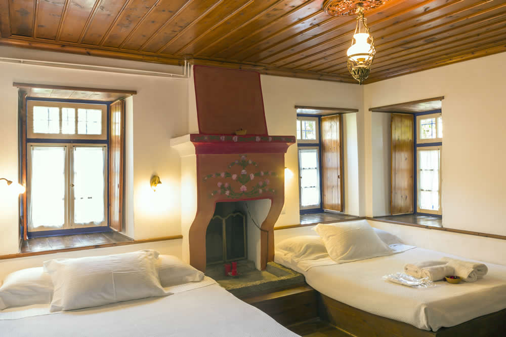 Accommodation M. Papigo, Zagori, Epirus | Superior Room (3pax): 23 square meters of total private space, One Double/twin Bed, One Single Bed, Laura Ashley Linens, Coco-Mat Mattresses and Pillows, En-Suite Bathroom, Hair Dryer, Bathroom Amenities, Scented Candles, Coffee/Tea Making Facilities, Daily Housekeeping, Bathtub, Rainfall Showerhead, Free Wi-Fi, Pillow Menu
